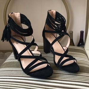Strappy black heels with tassels
